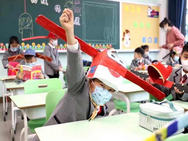 foto scuola cina cappelli